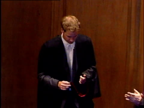 prince william kneels to receive cap and gown at graduation ceremony university of st andrews fife 23 june 2005 - graduation gown stock videos and b-roll footage