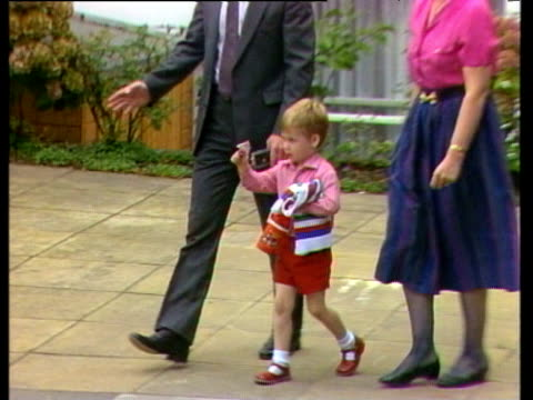prince william leaves nursery following his first day holding finger puppet sweater and drink flask london; 24 sep 85 - britisches königshaus stock-videos und b-roll-filmmaterial