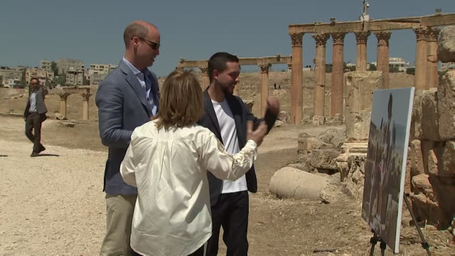 Prince William looking at a picture of a young Kate Middleton in Jerash Jordan