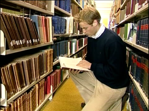 prince william looking at books in university of st andrews library scotland; nov 04 - st. andrews scotland stock videos & royalty-free footage