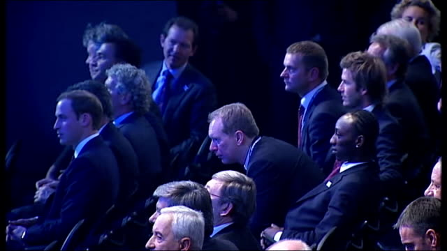 prince william looking unhappy seated with other delegates at fifa announcement of 2018 world cup bid reporter to camera william speaking with... - bid stock videos & royalty-free footage