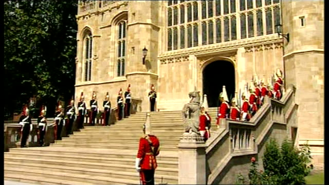 arrivals and departures at st george's chapel departures from chapel led by yeoman of the guard followed by military knights of windsor others in... - st. george's chapel stock videos and b-roll footage