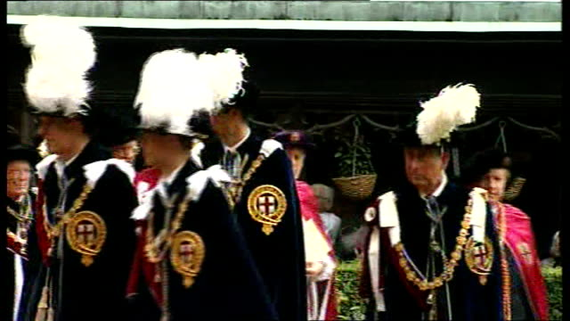 prince william made knight of the garter; england: berkshire: windsor: ext unidentified royal knights of the garter along in procession of the order... - headwear stock videos & royalty-free footage