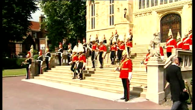 Royal Bodyguards on duty ENGLAND Berkshire Windsor Castle St George's Chapel EXT Dismounted squadrons of the Royal Household Cavalry wearing red...