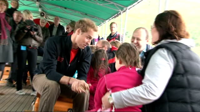 prince william meets children on steamboat ride on ullswater more shots of prince william chatting to parents and children natsot william hugging... - 2009 stock videos & royalty-free footage