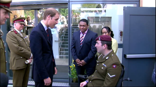Prince William opens new Help for Heroes rehabilitation centre at Headley Court Prince William along and looking at plaques on ground TILT UP...