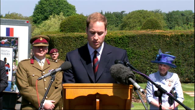 stockvideo's en b-roll-footage met prince william opens new pool and gym area at headley court; england: surrey: headley court: int prince william talking to soldier in wheelchair... - vrijetijdsfaciliteiten