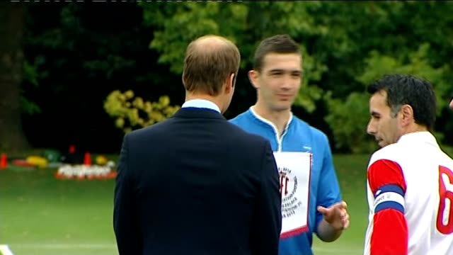 prince william organises football match at buckingham palace prince william talking to aides / wiilliam posing for photocall with captains of teams... - greg dyke stock videos & royalty-free footage