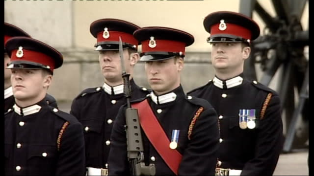 prince william passing out parade at sandhurst military academy; more of middleton watching parade, consulting programme / close up of william on... - sideways glance stock videos & royalty-free footage