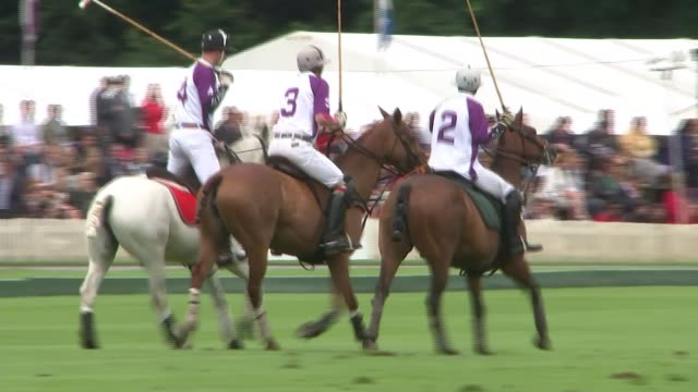Gloucestershire Cirencester Park Polo Club EXT Various of Prince William Duke of Cambridge taking party in polo match / Prince William at...
