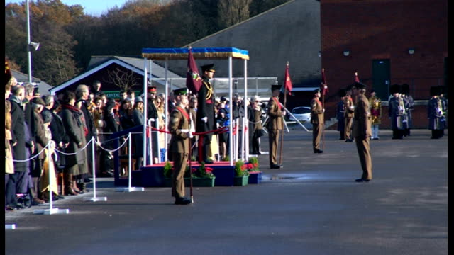 prince william presents medals to soldiers in aldershot; officer salutes prince william who returns salute - aldershot stock videos & royalty-free footage