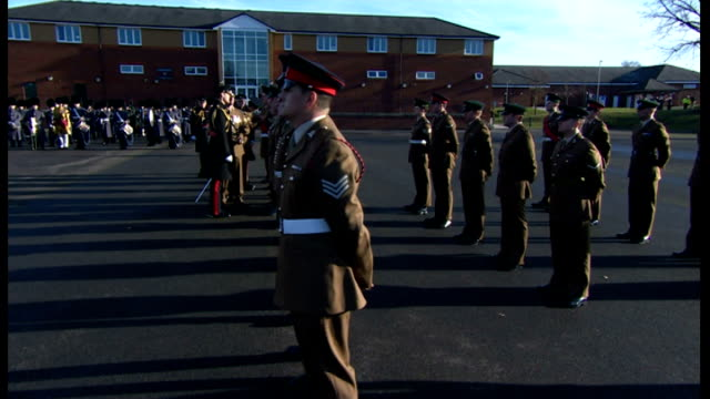 stockvideo's en b-roll-footage met prince william presents medals to soldiers in aldershot prince william handing out medals and talking to soldiers on parade during ceremony with as... - aldershot