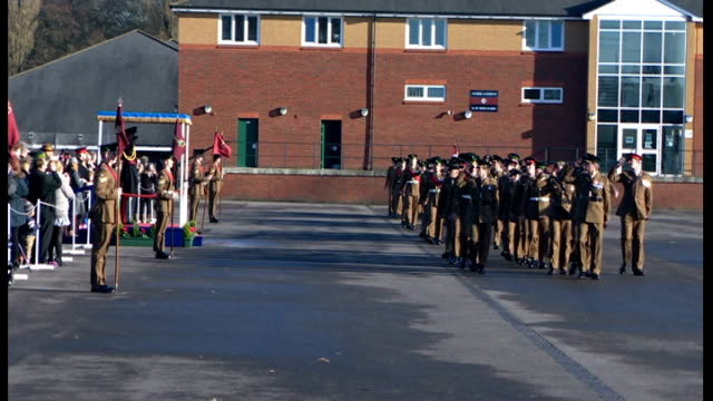 prince william presents medals to soldiers in aldershot soldiers marching to military band on parade ground sot / soldiers marching past prince... - aldershot stock videos & royalty-free footage