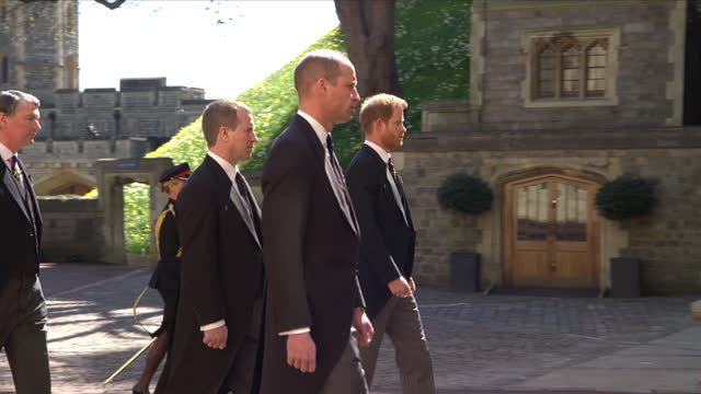 """prince william, prince harry and peter phillips walking behind the land rover hearse in the funeral cortege for their grandfather prince philip, duke... - """"bbc news"""" stock videos & royalty-free footage"""