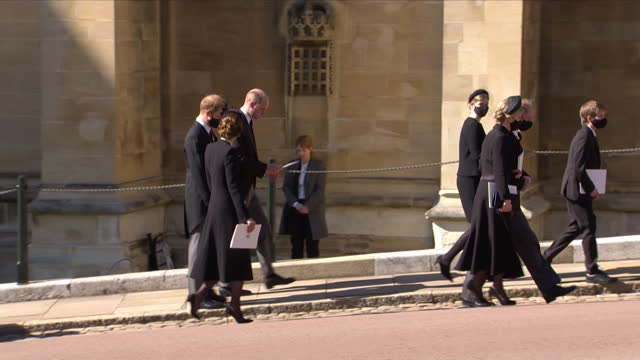 prince william, prince harry and the duchess of cambridge walking together as the royal family leave st george's chapel after the funeral of prince... - place of worship stock videos & royalty-free footage