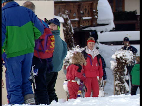 Prince William Prince Harry Princess Beatrice and Princess Eugenie trudge through the snow on a skiing holiday in Klosters