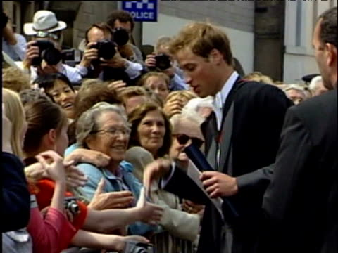 prince william shaking hands with well wishers after graduation from st andrews fife; 23 june 2005 - st. andrews scotland stock videos & royalty-free footage