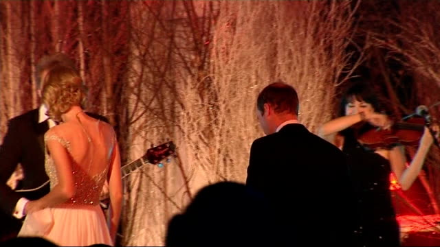 Prince William sings with Jon Bon Jovi and Taylor Swift at Winter Whites Gala London Kensington Palace INT **Music heard SOT** Jon Bon Jovi...