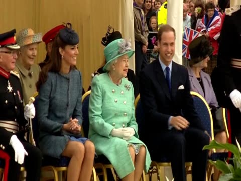 Prince William sits and talks with Queen Elizabeth II and the Duchess of Cambridge at an event at Vernon Park for the Diamond Jubilee