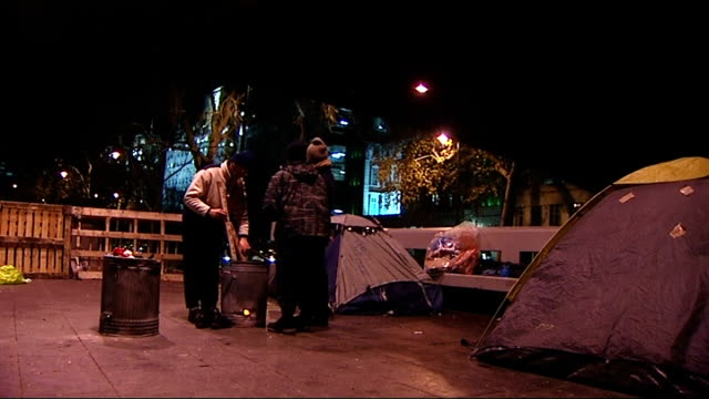 prince william sleeps rough in london to raise awareness of homelessness; england: london: ext / night homeless people standing next to tents two... - sleeping stock videos & royalty-free footage