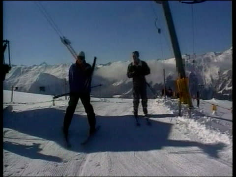 prince william speaks on future lib klosters ext prince william prince charles towards past on ski tow during skiing holiday prince william skiing... - ski holiday stock videos & royalty-free footage