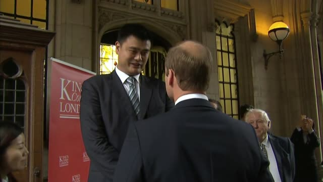 prince william speech on poaching broadcast on chinese state youth tv; england: london: king's college: ext **beware flash photography** prince... - king's college cambridge stock videos & royalty-free footage