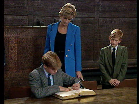 prince william takes pen and signs eton college register with left hand as princess diana and prince harry look on berkshire 06 sep 95 - eton berkshire stock videos and b-roll footage