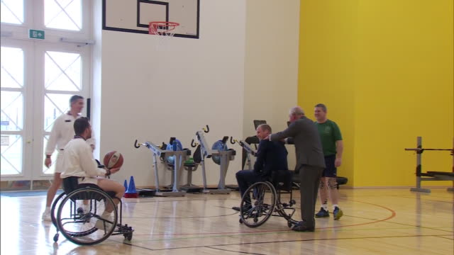 prince william taking part in wheelchair basketball on a visit to a military rehabilitation centre in loughborough - shooting baskets stock videos & royalty-free footage