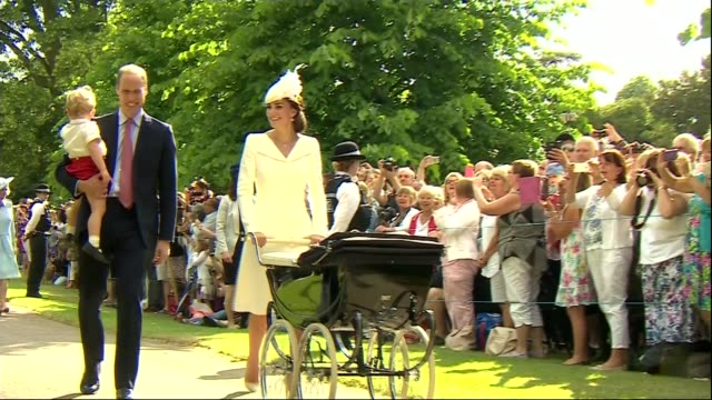 Prince William talks of the effect of becoming a father T05071506 / 572015 Sandringham Catherine Duchess of Cambridge aloing pushing pram carrying...