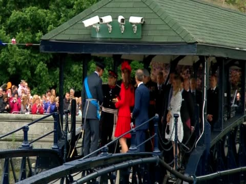 Prince William the Duchess of Cambridge and Prince Harry walking on footbridge to board Royal barge for Diamond Jubilee pageant