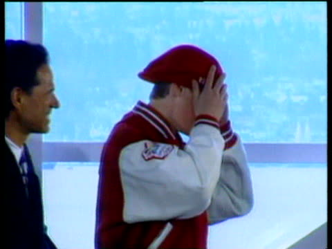 Prince William tries on and poses in sports team hat and jacket as Prince Charles and Prince Harry look on smiling Canada 20 Jun 98