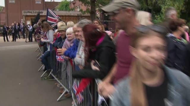 prince william unveils frank foley statue in stourbridge; england: west midlands: stourbridge: ext crowds line road waving union flags / prince... - uniform stock videos & royalty-free footage