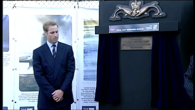 prince william visit to royal navy submarine museum; prince william unveils small plaque to officially open area of remembrance and memorial wall in... - 飾り板点の映像素材/bロール