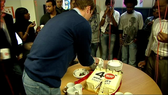 prince william visits centrepoint homeless charity on its 40th anniversary prince william cuts centrepoint birthday cake / prince william handing out... - 2009 stock videos & royalty-free footage