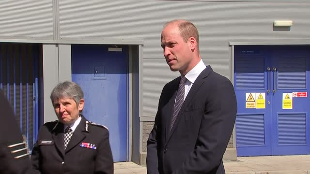 prince william visits croydon custody centre; england: london: croydon: ext gvs police officers with police wellbeing dog / prince william, duke of... - wellbeing stock videos & royalty-free footage