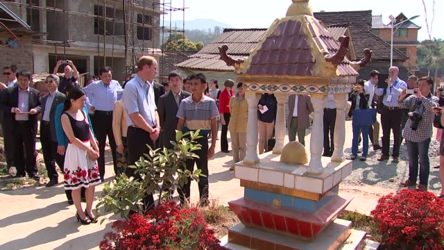 Prince William visits Mengaman village CHINA Xishuangbanna Prince William Duke of Cambridge along / William at local shrine / William chats to...