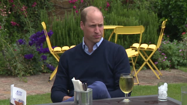 prince william visits pub ahead of them reopening after coronavirus lockdown, sits in beer garden and drinks cider and eats chips - opening stock videos & royalty-free footage