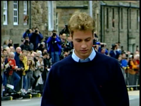 prince william walks towards camera on first day at st andrews university; 23 sep 01 - st. andrews scotland stock videos & royalty-free footage