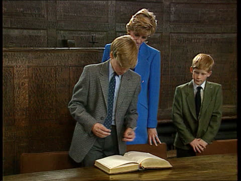 princes call for end to mourning as harry starts at eton; ltn: tim willcox lib england: berkshire: eton: int diana, princess of wales and prince... - 1日目点の映像素材/bロール