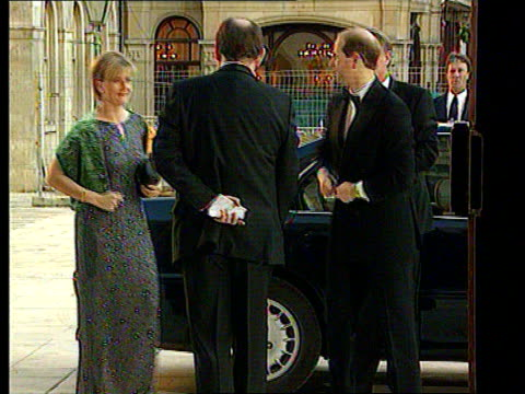 princes charles and edward; uk pool england: london: ext lms prince edward & fiance sophie rhys-jones towards as arriving at dinner dance int bms... - sophie rhys jones, countess of wessex stock videos & royalty-free footage