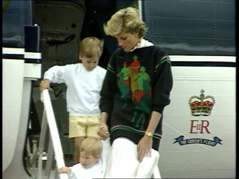 princes collection 1 inj3757 scotland aberdeen royal plane taxiing diana and princes william and harry down plane's steps and greeted into car and... - aberdeen scotland stock videos & royalty-free footage
