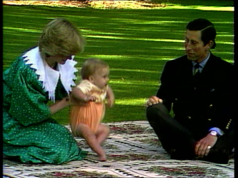 Princes Collection 1 INJ792 Auckland Government House Prince and Princess of Wales carrying Prince William towards into garden all sit on rug for...