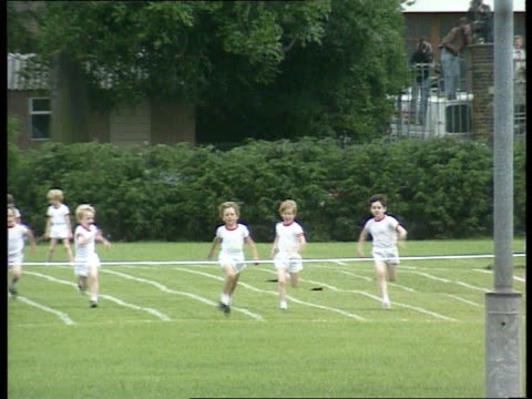 princes collection 1 rushes 11691 prince henry's sports day princess diana in mother's race england london richmond wetherby school prince princess... - sack race stock videos & royalty-free footage