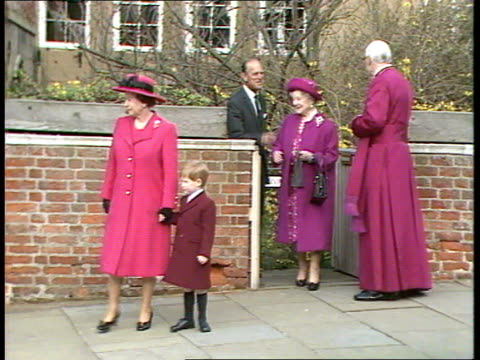 princes collection 1 rushes 26389 berkshire windsor queen elizabeth ii holding prince harry's hand out of church gate followed by queen mother prince... - collection stock videos and b-roll footage
