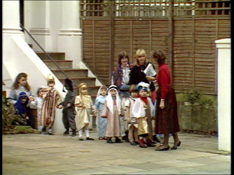 princes collection 1; rushes 8.12.88 8.12.88 prince harry nativity play. england: london: north kensington: children out of school zoom in to prince... - キリスト降誕点の映像素材/bロール