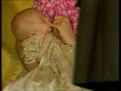 princes collection 1 tx prince william's christening london buckingham palace baby prince william sucking princess of wales' finger at christening... - prince william stock videos & royalty-free footage
