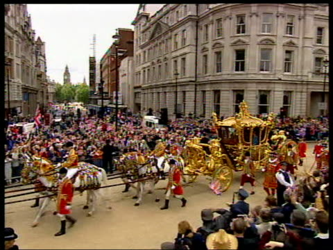 queen's golden jubilee england london queen and duke of edinburgh along in golden coach crowds waving flags prince william prince harry along in open... - carriage stock videos and b-roll footage