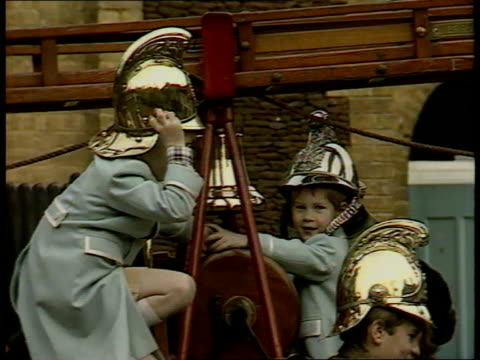 princes collection 3; r 3.1.88 royal family photocall at sandringham england: sandringham: prince william and harry wearing firemen's helmets on... - イーストアングリア点の映像素材/bロール