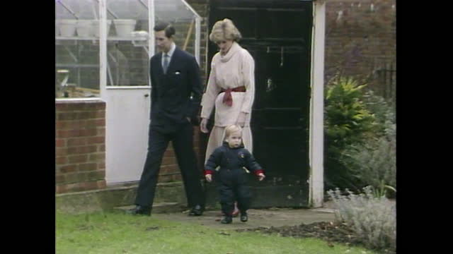 princes diana and prince charles bring 18-month old prince william into a walled garden at kensington palace during a press photo call. - toddler stock videos & royalty-free footage