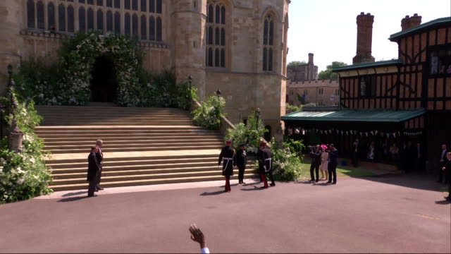 princes harry and william make their way into st george's chapel for prince harry's wedding to meghan markle. - uniform stock videos & royalty-free footage